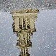 Ferry building in puddle