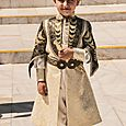 Boy in circumcision costume