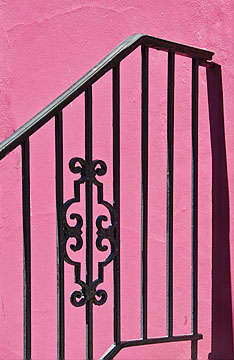 Railing on pink building